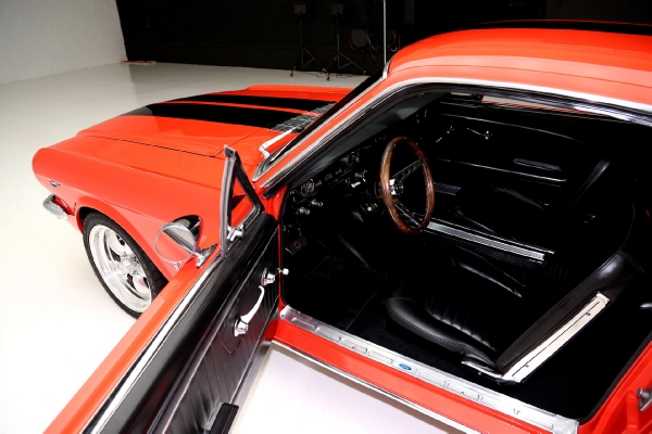 For Sale Used 1965 Ford Mustang Fastback poppy red, blk interior | American Dream Machines Des Moines IA 50309